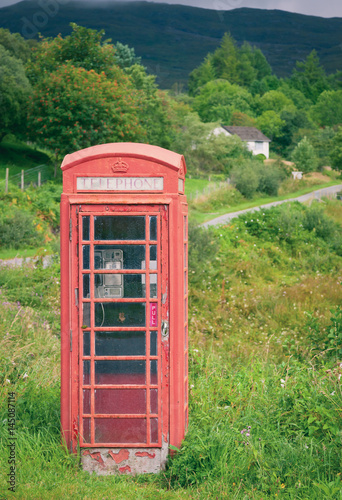 Old weathered red telephone kiosk in Scotland Poster