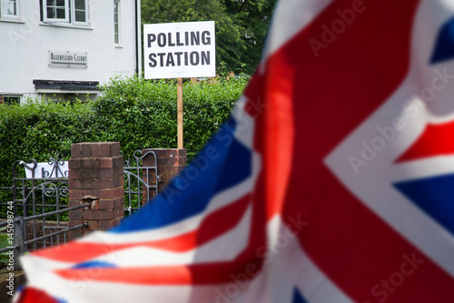 polling station sign and Union Jack flag - UK prepares for elections Poster