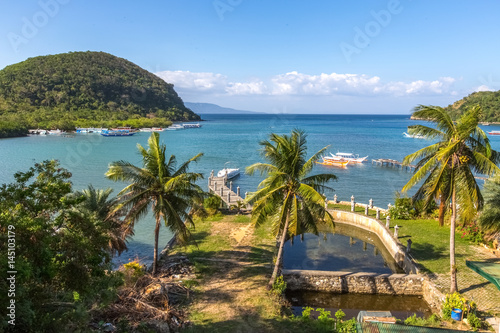 Puerto-Galera, Philippines -  view on Balatero Cove bay fishermans village and boats