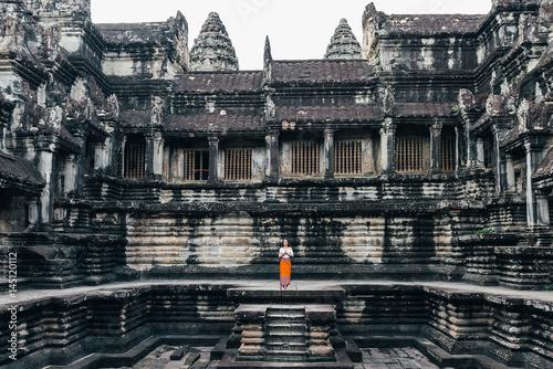 Woman Praying in Angkor Wat Temple.