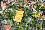 Stockholm terrorist truck attack on April 12, 2017 - flowers, candles, and card on street from people praying for victims