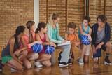 Female coach mentoring high school kids - 145127533