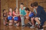Female coach mentoring high school kids - 145127578