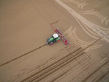tractor - aerial view of a tractor at work cultivating a field in spring