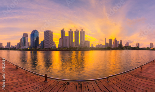 panorama of buildings in city at morning with golden hour.