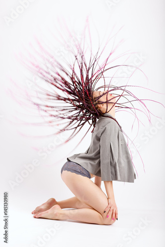Young slender girl with long afro pigtails Poster