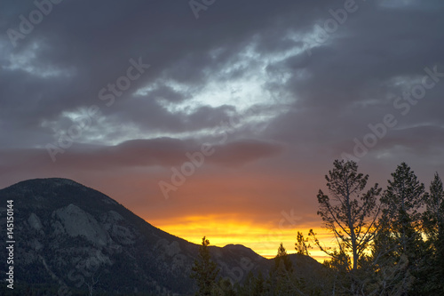Clouds at sunrise in Colorado Rockies Poster