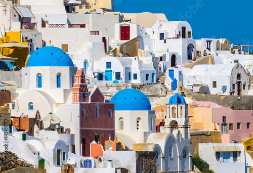 Traditional white architecture with blue churches on Santorini island Greece