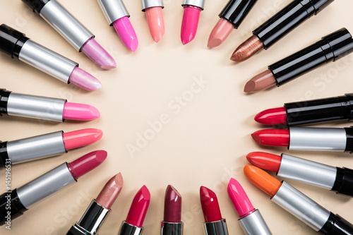 Various Colorful Lipstick Arranged In A Circle Плакат