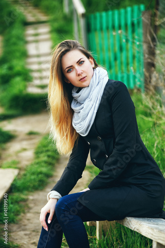 Poster portrait of a beautiful girl on the nature