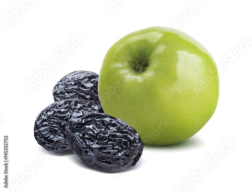 Poster Whole green apple back and dry plums isolated