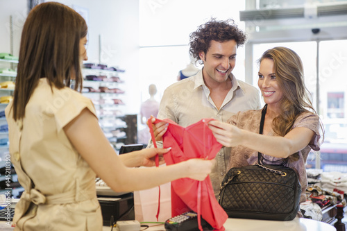Couple Buying Clothes Poster