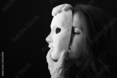 Beautiful brunette girl holding a theatrical mask in white gloves Poster