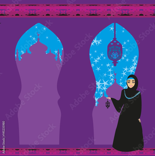 Beautiful muslim women on mosque background.