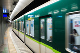 Interior of a Tokyo subway station and platform with subway commuters in Tokyo, Japan. - 145241139