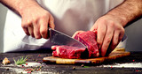 Man cutting beef meat - 145257590