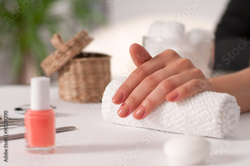 Poster  Hand care. Beautiful manicure, woman's hands in the spa