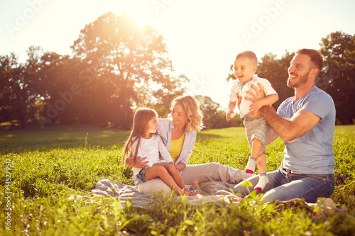 Young parents with children on picnic