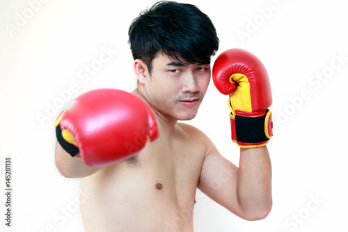Juliste Handsome muscular young man wearing boxing gloves