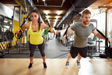 Fototapeta Couple on body training in gym