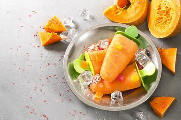 Homemade orange ice cream on a stick