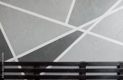 white stripes on gray background. Painted concrete wall, - 145324386