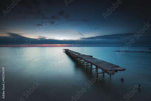Old broken bridge in the sea, long exposure Poster