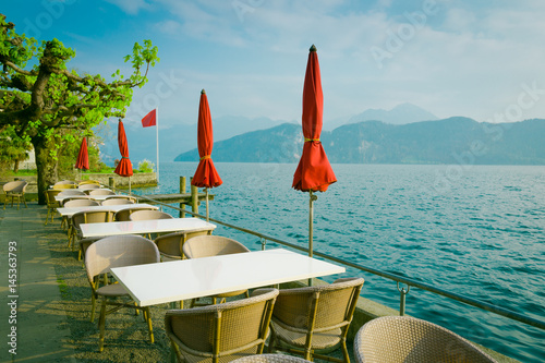 Outdoor restaurant over lake and mountains