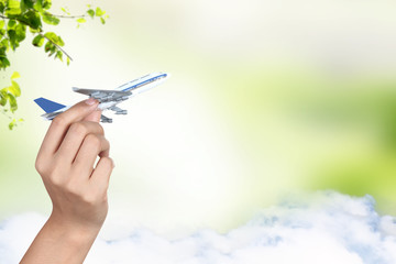 hand holding airplane