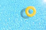yellow swimming pool ring float in blue water. concept color summer. © barameefotolia