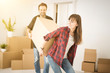 A young couple is introduced into a new apartment.
