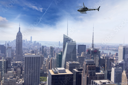 Deurstickers New York Helicopter for sightseeing over Manhattan.
