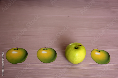 Poster 3d apple among 2d apples on the table