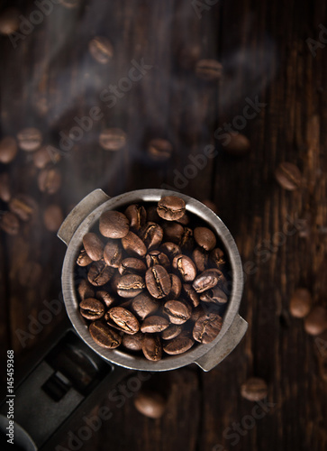 Fotobehang Koffiebonen Fresh coffee beans in coffee maker.