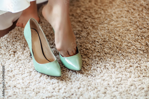 turquoise high-heeled shoes