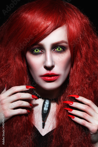 Vintage style portrait of young beautiful redhead woman with gothic Halloween ma Poster