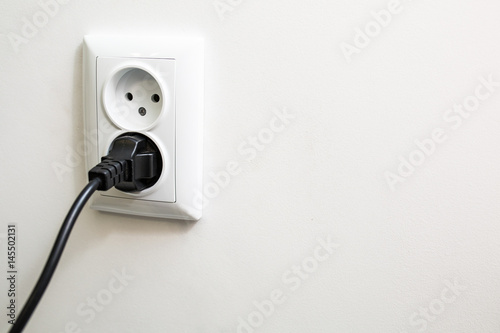 Cable Wall Outlet : European white electrical outlet socket and black cable on