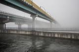 bridge over Vistula river in Krakow in heavy fog.