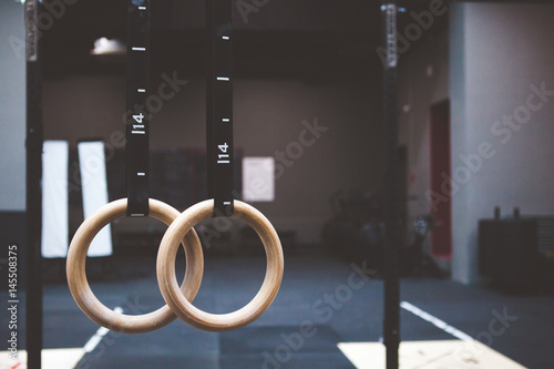 gymnastic rings in fitness gym Poster