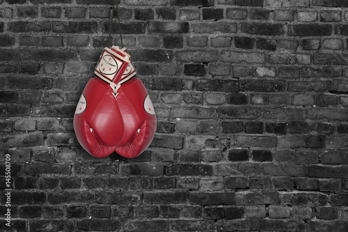 Poster red boxing gloves on a brick wall background
