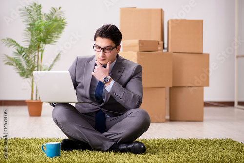 Businessman sitting on the carpet in office Poster