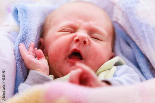 Poster Little newborn baby sleeping calmly in blanket