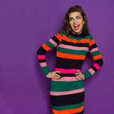 Excited And Shouting Woman In Multicolored Striped Dress - 145542310