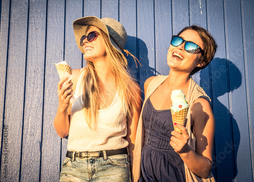 Two girls eating ice-cream