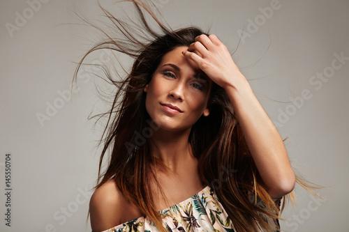 Poster woman with hair flying in air