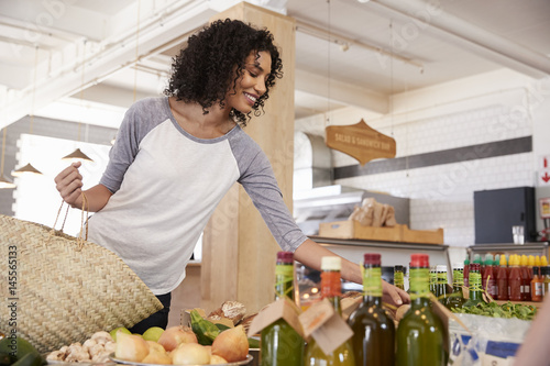 Woman Shopping For Organic Produce In Delicatessen - 145565133