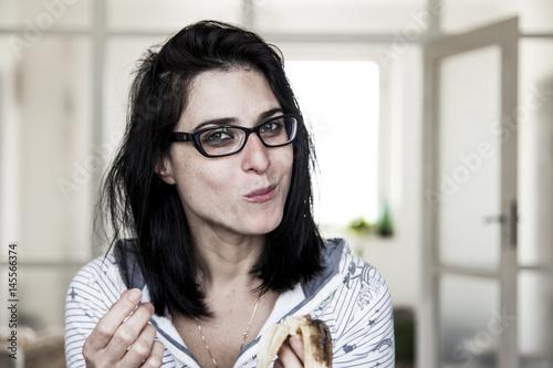 Woman Eating Banana for Breakfast Poster