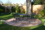 Patio in an English garden in the evening light - 145586771