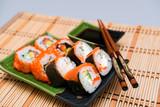 sushi plates and chopsticks