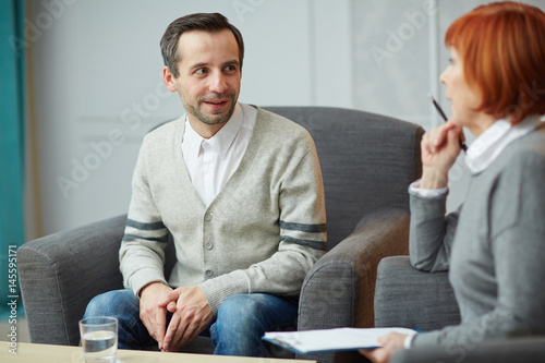 Young man discussing his problems with psychiatrist